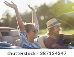 young couple in his convertible ... | Shutterstock . vector #387134347