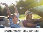 young couple in his convertible ... | Shutterstock . vector #387134833