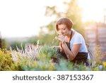 young gardener in garden... | Shutterstock . vector #387153367