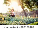 Young Gardener Cutting Little...