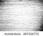grunge halftone vector... | Shutterstock .eps vector #387236773