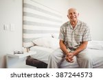 portrait of senior man sitting... | Shutterstock . vector #387244573