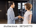 businessman shaking hands young ... | Shutterstock . vector #387245773