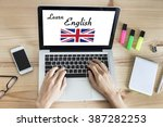 woman learning english online... | Shutterstock . vector #387282253