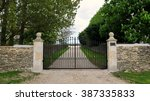 boundary wall and metal gates... | Shutterstock . vector #387335833