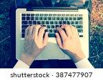 businessman hands typing on...   Shutterstock . vector #387477907
