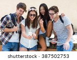 hip friends looking at... | Shutterstock . vector #387502753