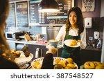waitress serving a cup of... | Shutterstock . vector #387548527