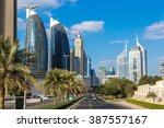 skyscrapers in dubai in a... | Shutterstock . vector #387557167