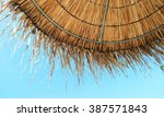 Straw Beach Umbrella On Blue...