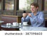 businessman using phone in...   Shutterstock . vector #387598603