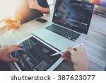 two colleagues website designer ... | Shutterstock . vector #387623077
