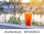 iced lemon tea with sliced... | Shutterstock . vector #387643813