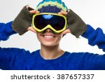 young woman with ski goggles ... | Shutterstock . vector #387657337
