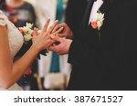 newlyweds exchange rings  groom ... | Shutterstock . vector #387671527
