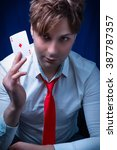 Small photo of man with ace of diamonds in hand