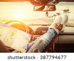 young woman alone car traveler... | Shutterstock . vector #387794677