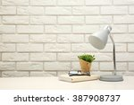 lamp and home decor on brick... | Shutterstock . vector #387908737