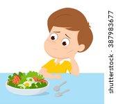 kid sad with his breakfast... | Shutterstock .eps vector #387983677