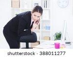 businesswoman talking on the... | Shutterstock . vector #388011277