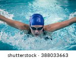 fit woman swimming in the pool | Shutterstock . vector #388033663