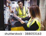 warehouse worker talking with... | Shutterstock . vector #388053163