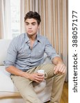stressed young man sitting on... | Shutterstock . vector #388057177