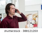 man talking on mobile phone... | Shutterstock . vector #388121203