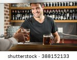handsome bar tender giving a... | Shutterstock . vector #388152133
