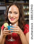 pretty woman having a cocktail... | Shutterstock . vector #388152943