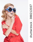 young woman in sunglasses  the... | Shutterstock . vector #388212037