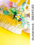basket with easter eggs on a... | Shutterstock . vector #388345183