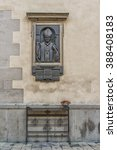 "Small photo of LVIV, UKRAINE - OCT 26, 2015: Monument to Pope John Paul IES in the wall of the old church ""The Latin Cathedral"""