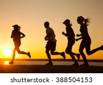group of young people runs at... | Shutterstock . vector #388504153