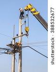 electricians repairing wire on... | Shutterstock . vector #388532677