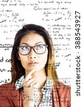 Small photo of Thoughtful businesswoman with eyeglasses against rocket science theory