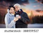 cheerful couple looking at the... | Shutterstock . vector #388559527