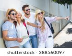 hip friends holding map and... | Shutterstock . vector #388560097