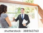 real estate agent giving keys... | Shutterstock . vector #388563763