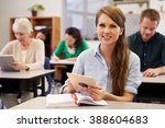 young woman at adult education... | Shutterstock . vector #388604683
