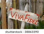 "Wooden propaganda sign ""Viva Fidel"" in Cuban countryside - stock photo"