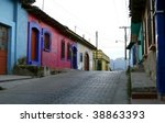 An empty street with typical Mexican houses, low architecture, bright and vibrant colors. San Cristobal de las  Casas, Chiapas, Mexico - stock photo