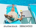 woman in hat relaxing at the... | Shutterstock . vector #388634503