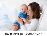 young mother holding her... | Shutterstock . vector #388644277