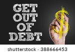 Small photo of Hand writing the text: Get Out Of Debt