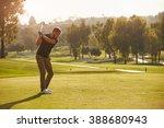 male golfer lining up tee shot... | Shutterstock . vector #388680943