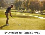 Male Golfer Lining Up Tee Shot...