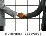 Small photo of Businessmen shake hands in headquarters. Managers greeting each other. Value your allies. Thanks for everything.
