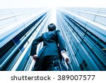 businessman looking up at the... | Shutterstock . vector #389007577