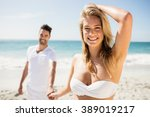 smiling couple holding hands on ... | Shutterstock . vector #389019217